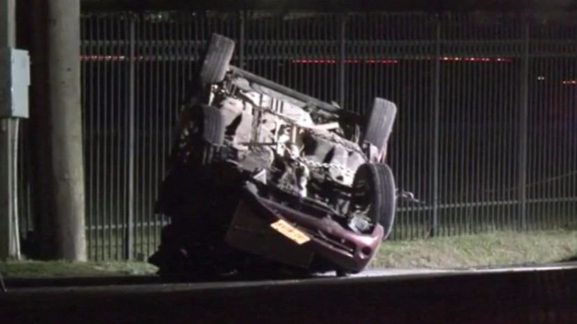 car flips over after crash in channelview
